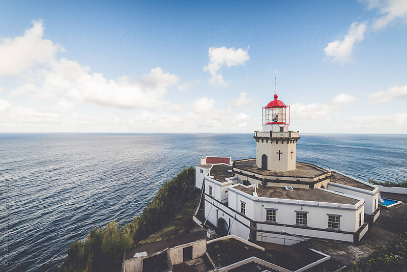 a lighthouse on a sunny day by Christian Zielecki for Stocksy United