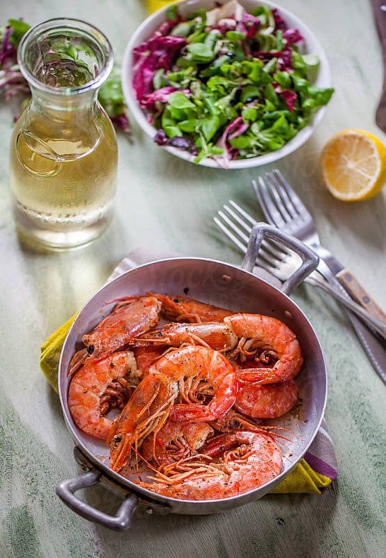 King prawns cooked in frying pan by Davide Illini for Stocksy United