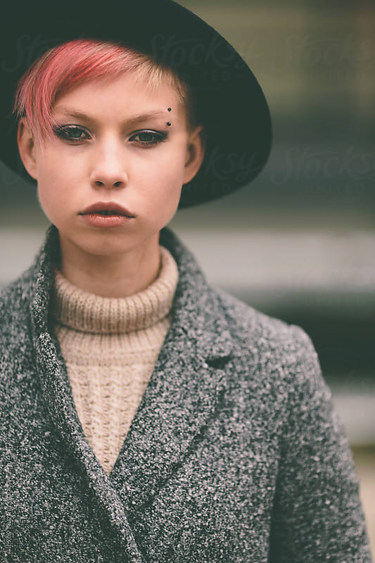 young woman with black hat  by Alexey Kuzma for Stocksy United