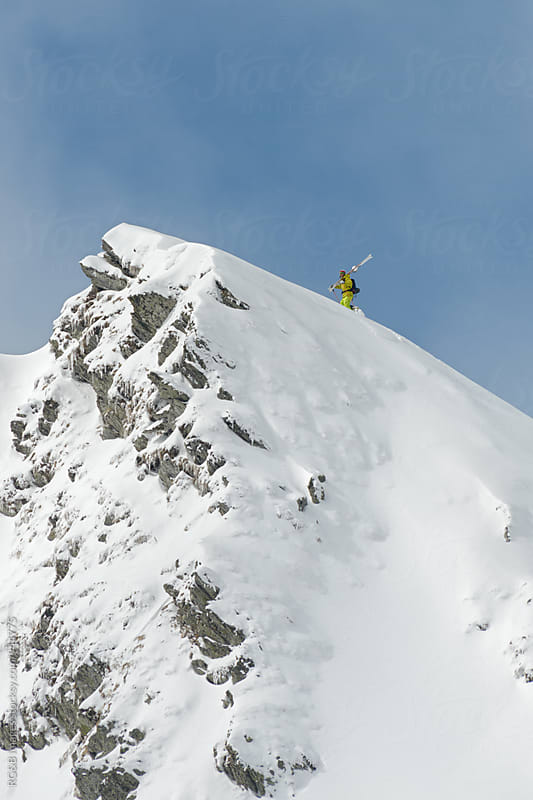 Skier reaching the top of the mountain by RG&B Images for Stocksy United