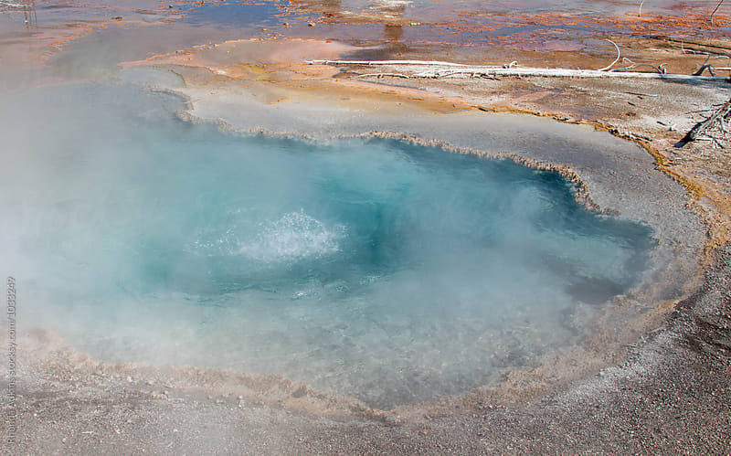 Beautiful steaming aqua hot spring by Rhonda Adkins for Stocksy United