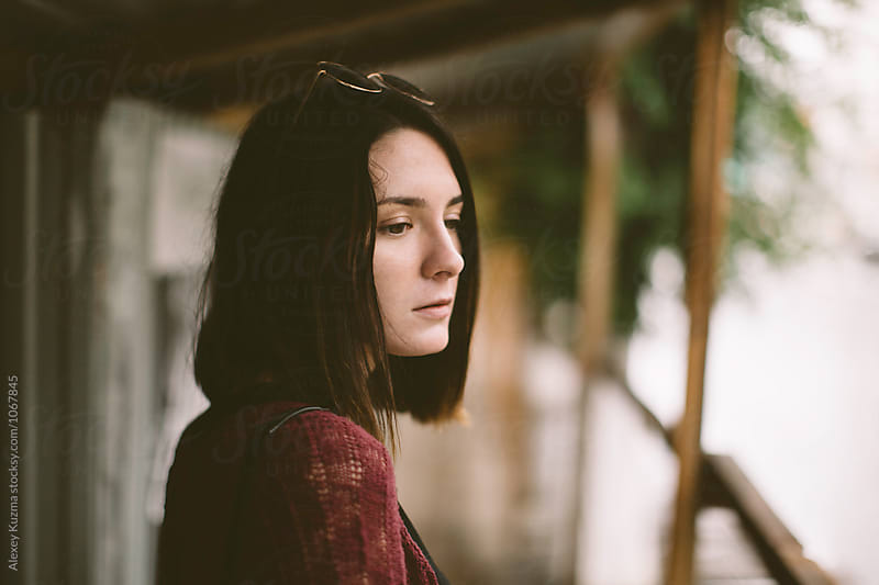 portrait of young woman on the street by Vesna for Stocksy United