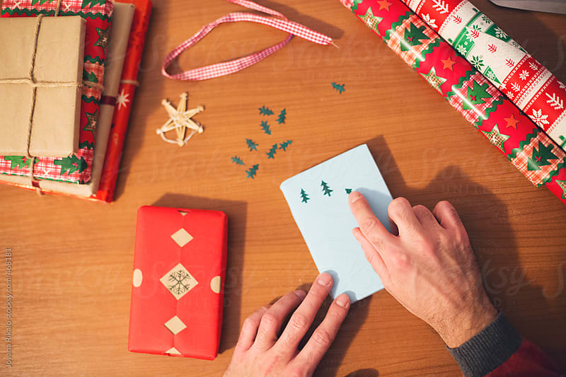 Man making Christmas gifts by Jovana Rikalo for Stocksy United