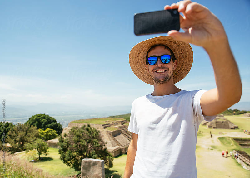 Tourist taking selfie against of landscape by Alejandro Moreno de Carlos for Stocksy United