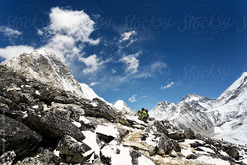 Man hiker in high Himalaya Mountains in Nepal. by Dejan Ristovski for Stocksy United