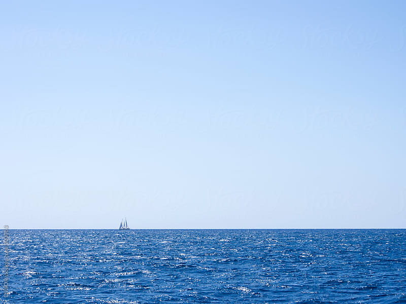 Distant yacht on the horizon in Turkish Riviera near Dalaman by DV8OR for Stocksy United