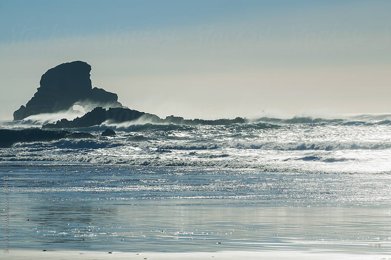 Waves crashing on shoreline rocks by Shelly Perry for Stocksy United