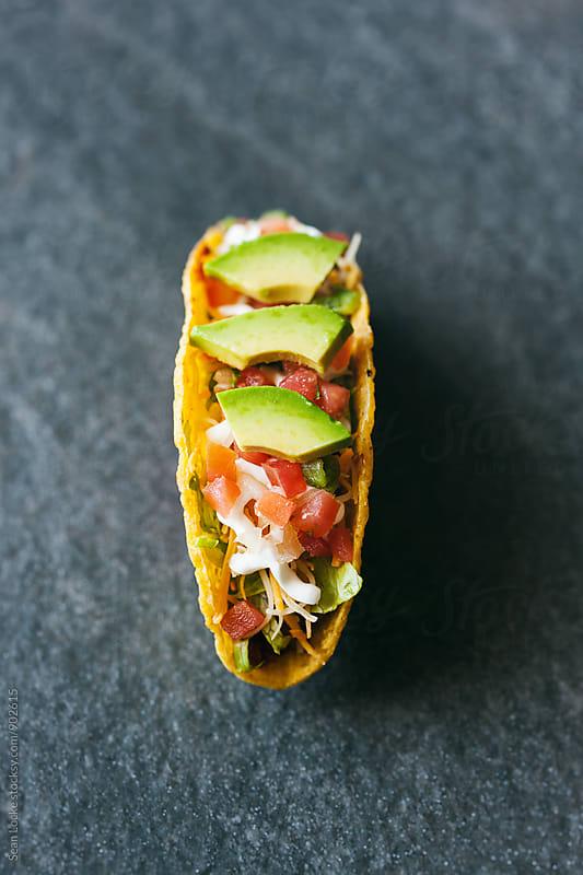 Tacos: Single Hard Shell Taco On Black Slate by Sean Locke for Stocksy United