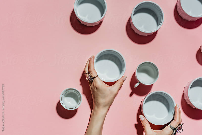 Hand with bowls by Tatjana Ristanic for Stocksy United