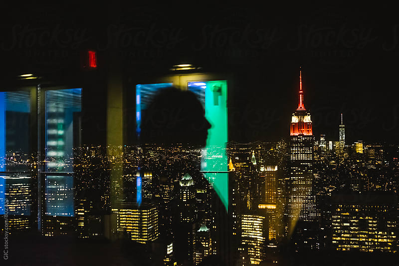 Woman on the top of NY by night by WAVE for Stocksy United