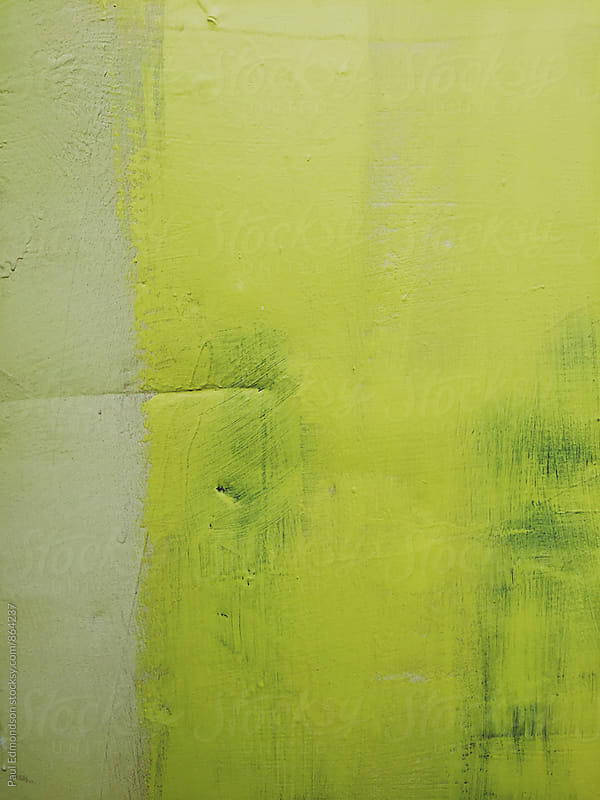Colorful yellow paint covering graffiti on metal wall by Paul Edmondson for Stocksy United