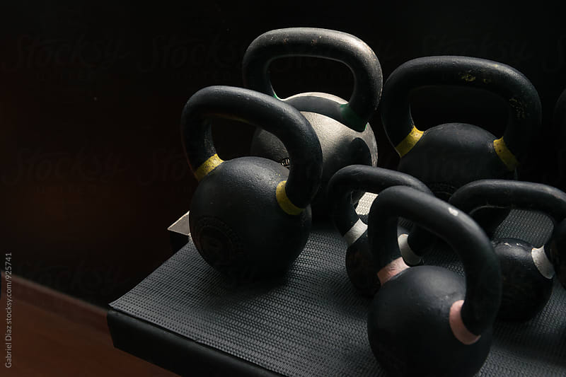 Kettlebells in a gym.  by Gabriel Diaz for Stocksy United