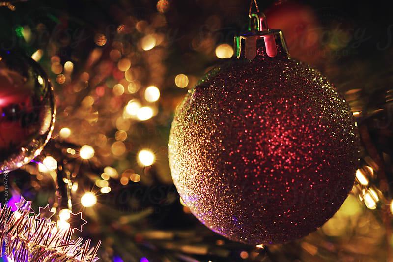 Glittery Christmas Bauble in tree by Kaat Zoetekouw for Stocksy United