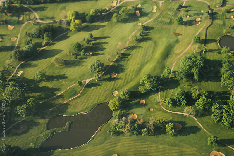 Bird's-eye view of a Chicago-area golf course, taken from an airplane by Kathryn Swayze for Stocksy United