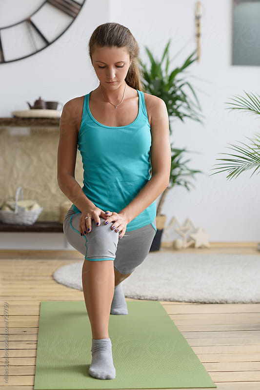 Sportswoman doing lunges by Milles Studio for Stocksy United