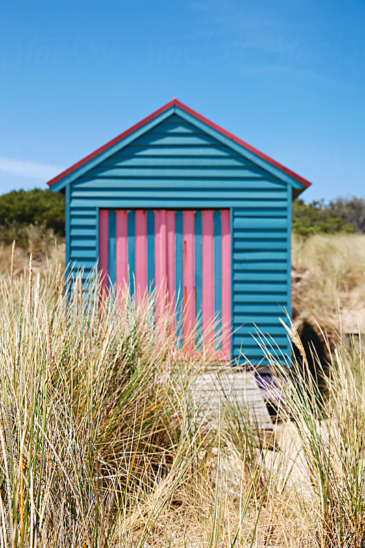 colourful bathing / beach huts on beach in Melbourne Australia by Natalie JEFFCOTT for Stocksy United