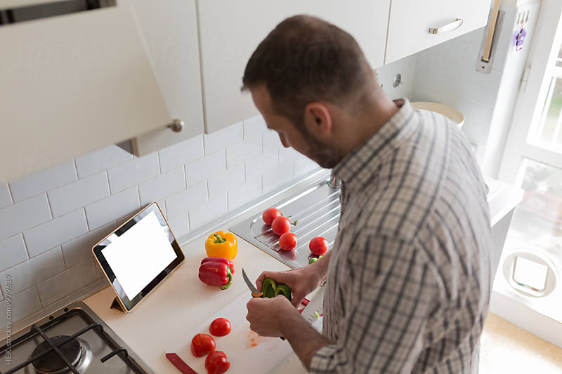 Man Cooking in the Kitchen with a Digital Tablet  by HEX. for Stocksy United