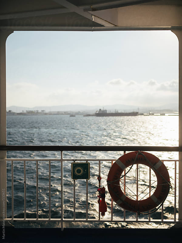 Framed view from ferry at sea and boats by Martin Matej for Stocksy United