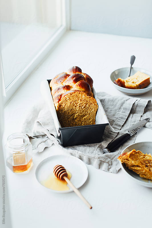 Freshly baked pumpkin challah by Ellie Baygulov for Stocksy United