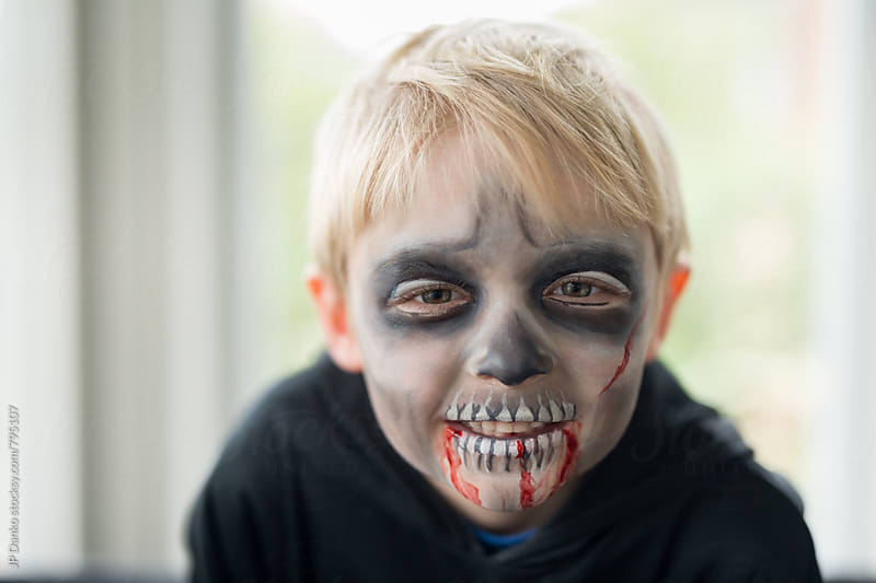 Smiling Little Boy With Scary Zombie Ghoul Halloween Costume Make Up by JP Danko for Stocksy United