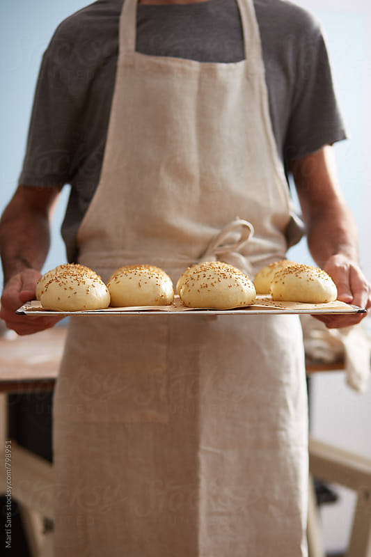 Raw homemade burger buns by Martí Sans for Stocksy United