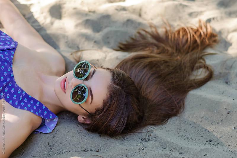 Beautiful Brunette Woman Lying on the Beach Sand by Aleksandra Jankovic for Stocksy United