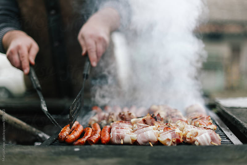 Skewers and sausages on a grill  by Marija Kovac for Stocksy United