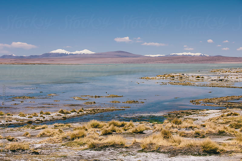 Lake in summer with mountains, Bolivia travel. by Alejandro Moreno de Carlos for Stocksy United