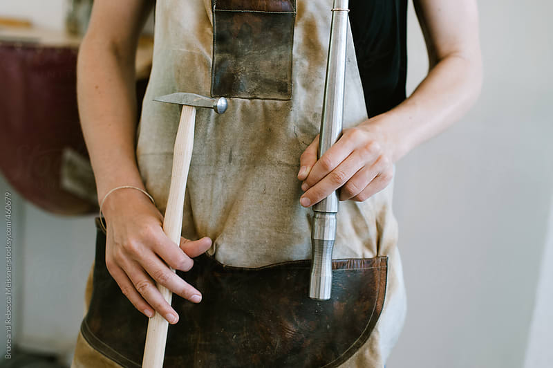 Girl making jewellery by Bruce and Rebecca Meissner for Stocksy United
