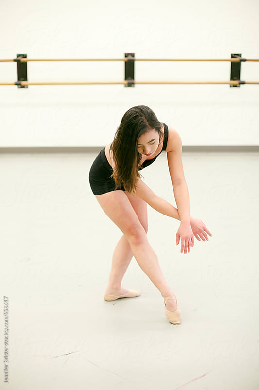 A female dancer by Jen Brister for Stocksy United