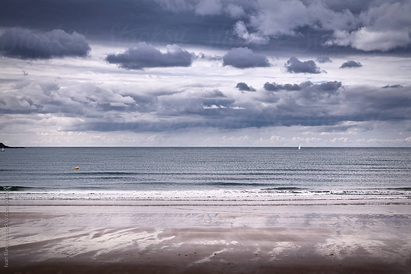 Empty beach on a cloudy day by Ivan Bastien for Stocksy United