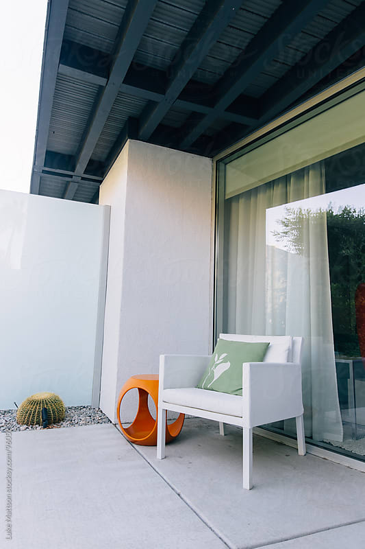 White Chair And Back Patio Of Private Resort Hotel Room by Luke Mattson for Stocksy United