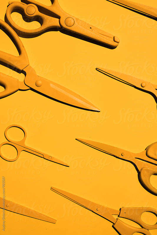 Yellow scissors on yellow background by Audrey Shtecinjo for Stocksy United