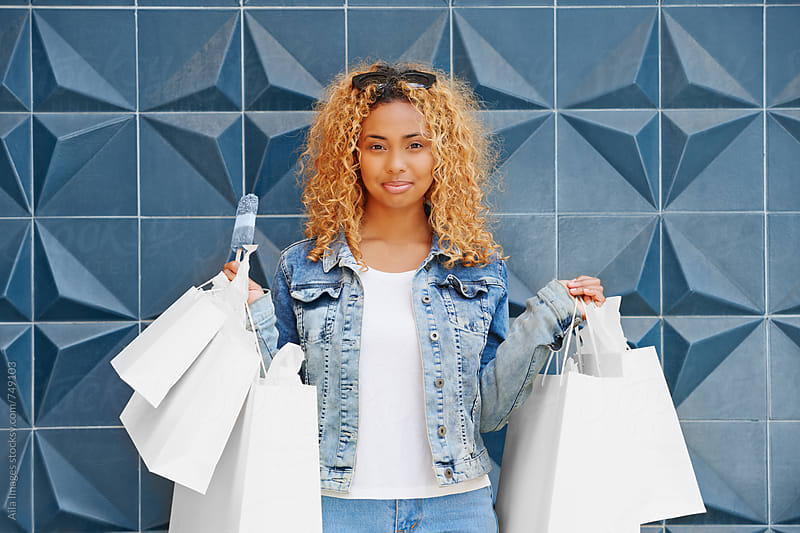 Double Denim trendy shopping Woman by Aila Images for Stocksy United