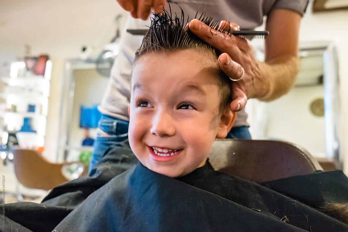 Cute Child Get A Haircut At The Barbershop Stocksy United