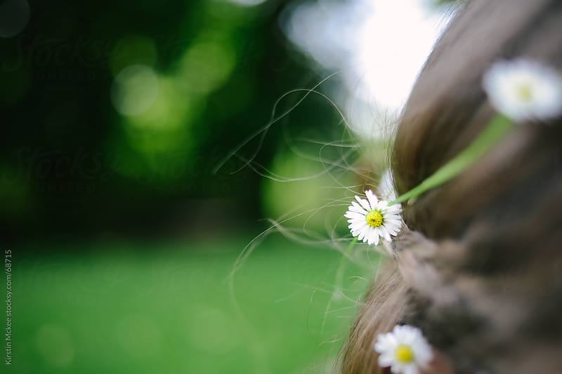 Girl with daisies in her hair by Kirstin Mckee for Stocksy United