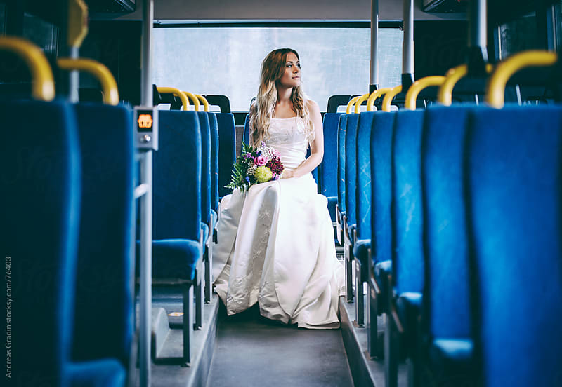 lonely bride on the bus by Andreas Gradin for Stocksy United