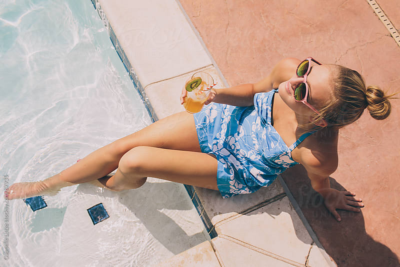 Cute Girl Relaxing by the Pool by Gabrielle Lutze for Stocksy United