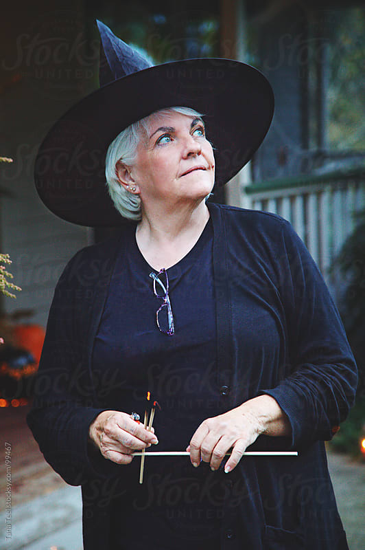 A woman dressed like a witch for Halloween by Tana Teel for Stocksy United