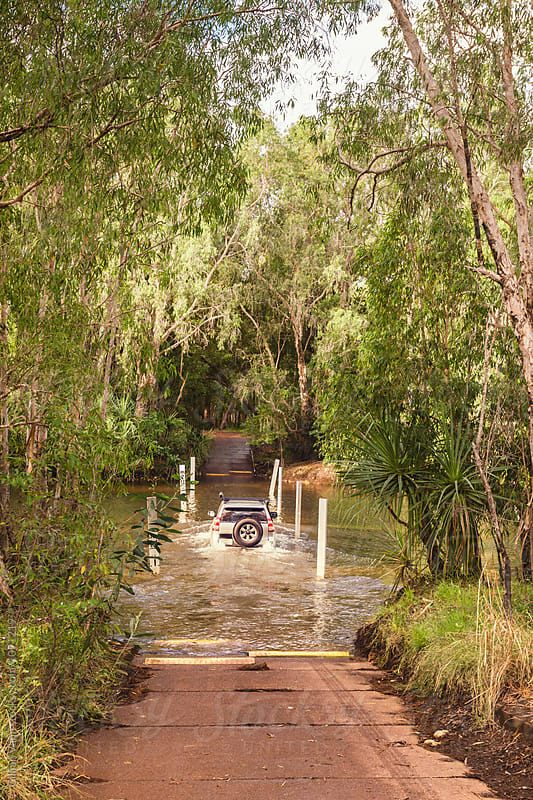 four wheel drive crossing a dangerous creek, Kakadu NP, NT, Australia by Gillian Vann for Stocksy United