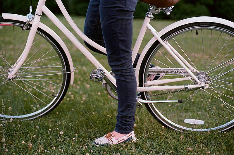 Woman and a bicycle by Liubov Burakova for Stocksy United