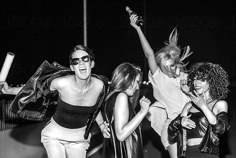 Four young female friends goung to the nightlife. by Audrey Shtecinjo for Stocksy United