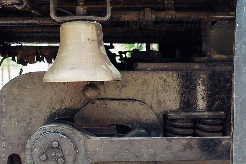 Brass bell on an old railway car by Gabriel (Gabi) Bucataru for Stocksy United