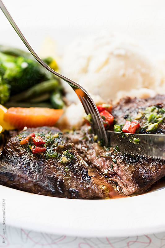 Argentinean Skirt Steak with Chimichurri Sauce by Jill Chen for Stocksy United