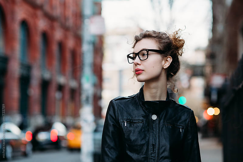 Attractive woman walking down the street in New York City by michela ravasio for Stocksy United