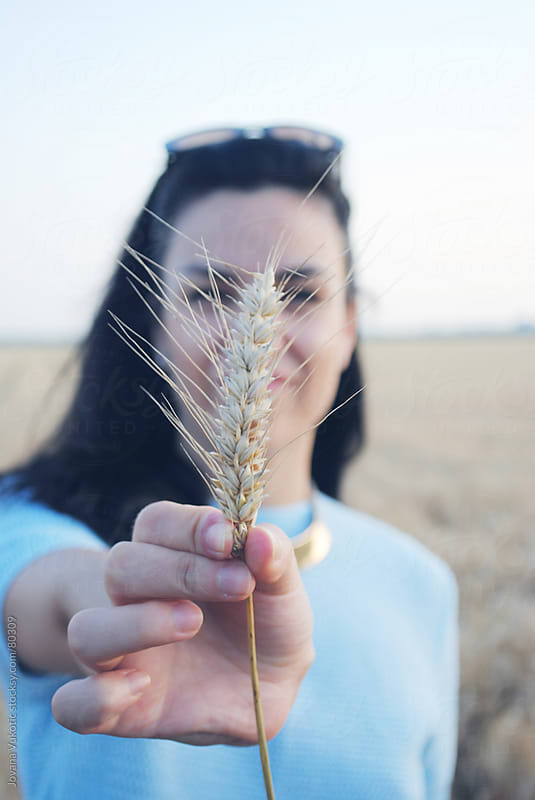 girl and wheat by Jovana Vukotic for Stocksy United