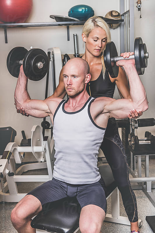 fitness couple in gym by Andreas Gradin for Stocksy United