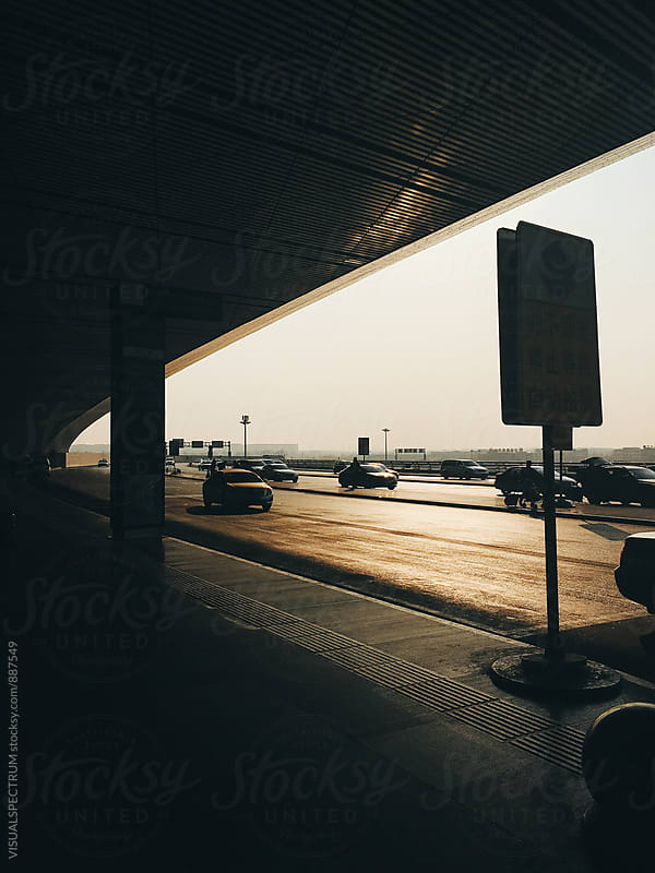 Silhouette of Cars in Front of Airport by Julien L. Balmer for Stocksy United