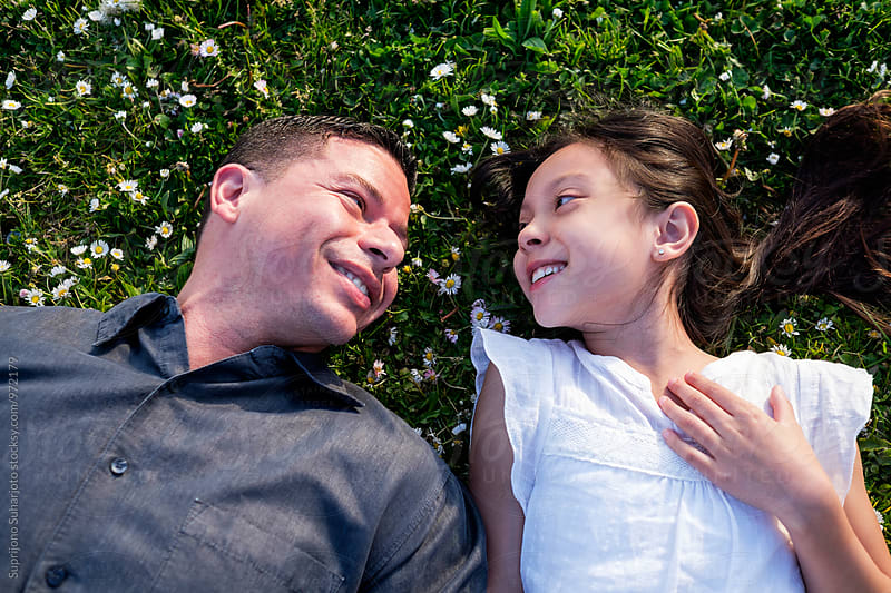 Happy Hispanic father and daughter spending time together outdoor by Suprijono Suharjoto for Stocksy United