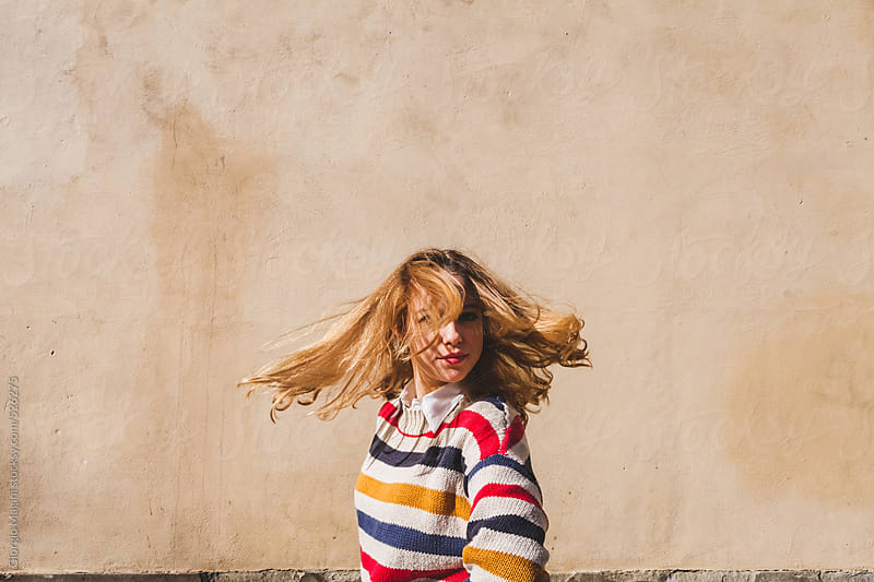 Blonde Teenage Girl Moving her Head and Hair by Giorgio Magini for Stocksy United